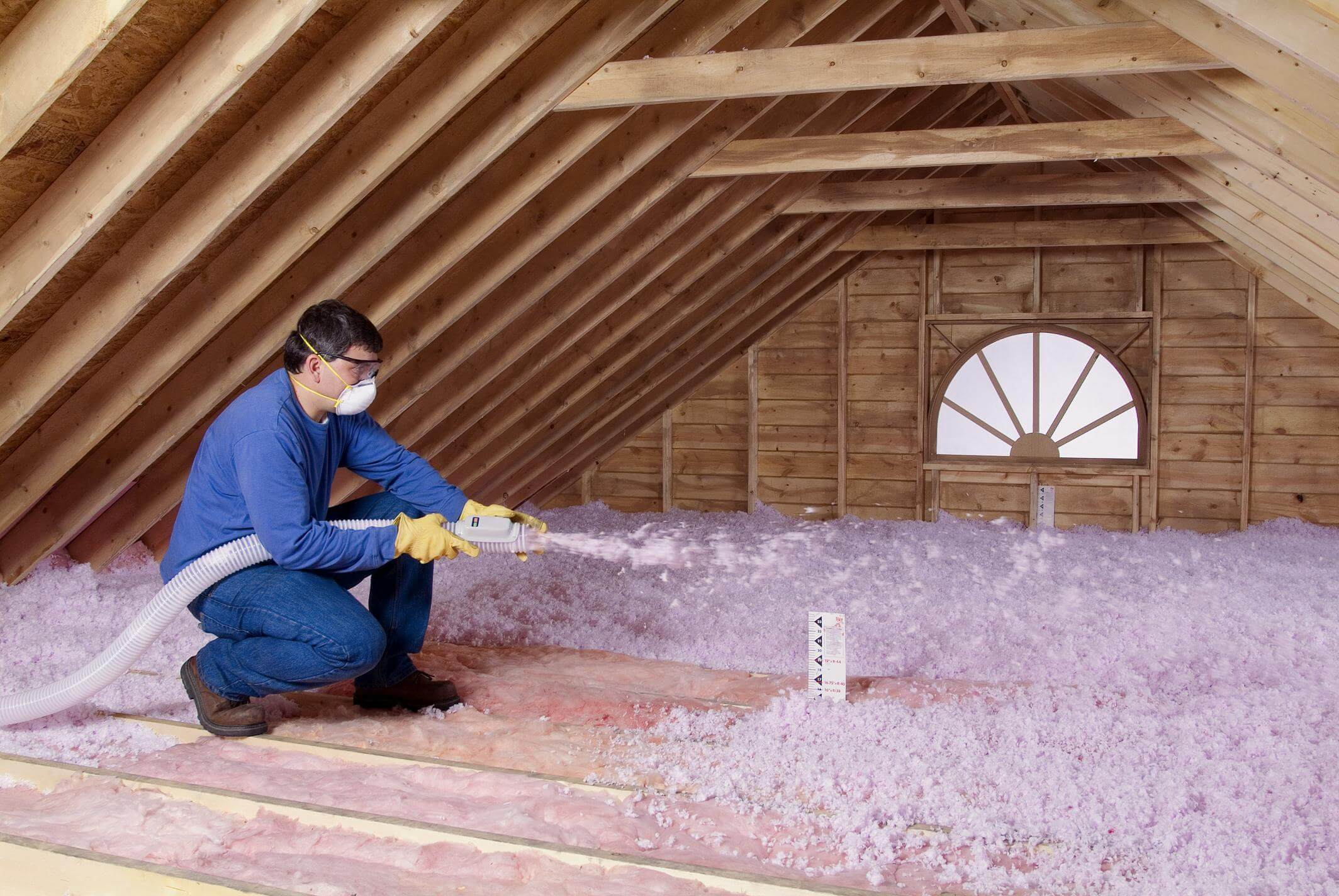 Contractor-Blowing-Insulation-in-an-unfinished-attic-1-1